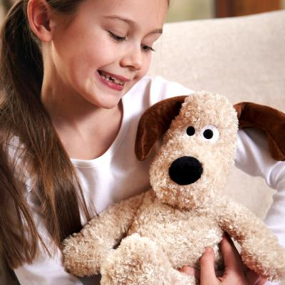 Gromit Official Heatable Soft Toy Heat Pack held by little girl