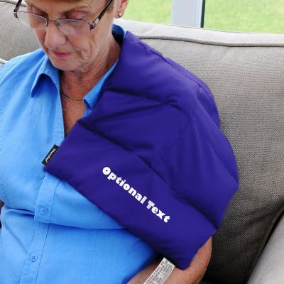 Wheat Bags Super Large Rectangle Heat Pack Lifestyle Image of Heat Pack Being used on Shoulder